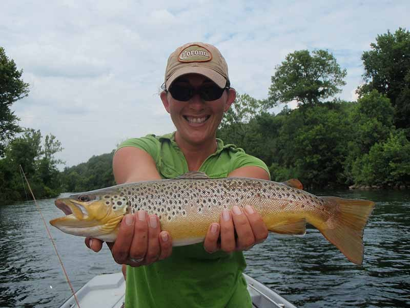The White River Inn, Woman trout fishing on the White River in Arkansas.