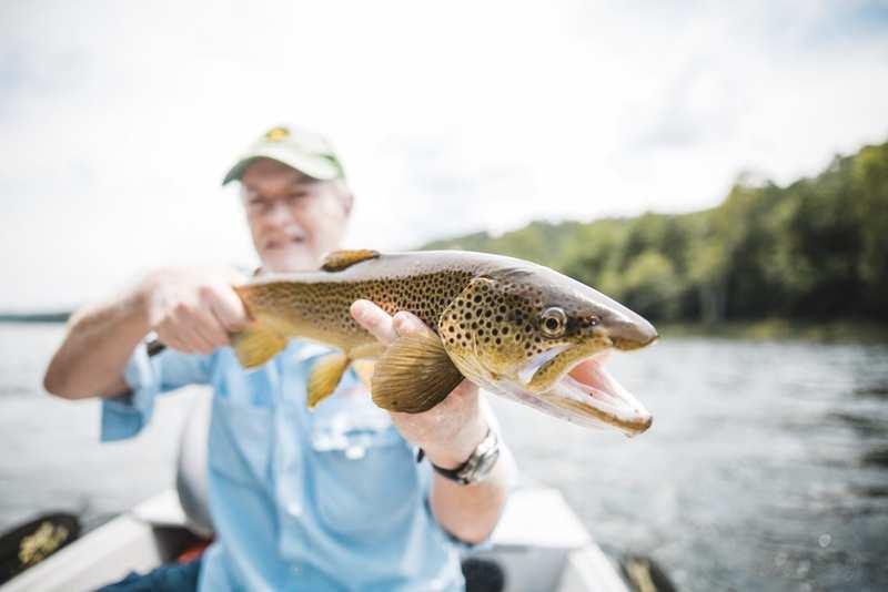 The White River Inn, Man trout fishing on the White River in Arkansas.
