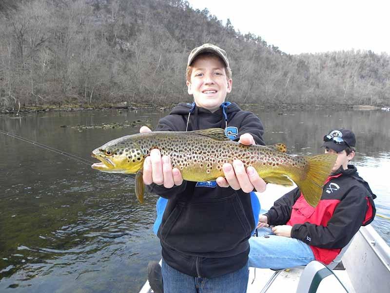 The White River Inn, Kid trout fishing on the White River in Arkansas.