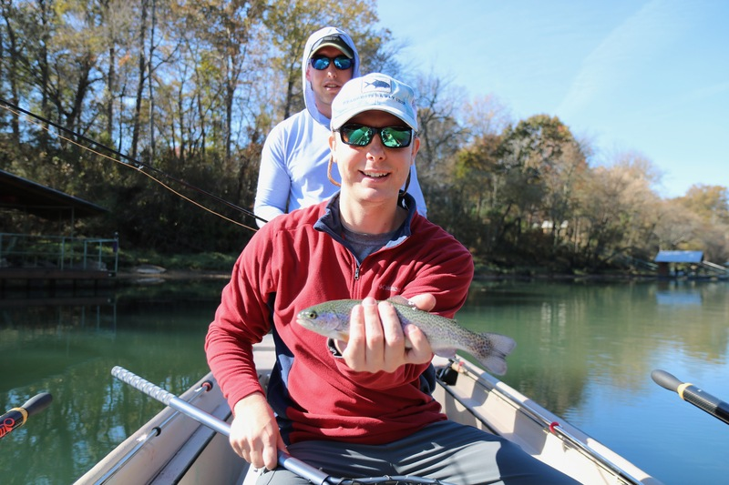 Blaine with is first fish on a fly.