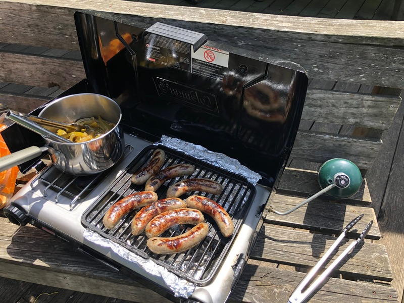 Brats grilling on the river.